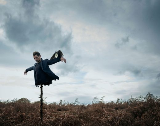 A man flying through the air on a cloudy day